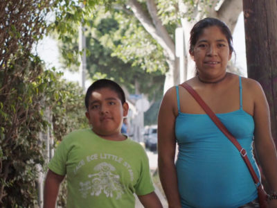 "Noemi, a low-wage worker and participant of the UCLA Labor Center program, ""Parent Worker Project,"" is walking with her son in Los Angeles."