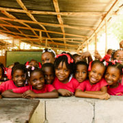 School children in Haiti dressed in red uniforms.