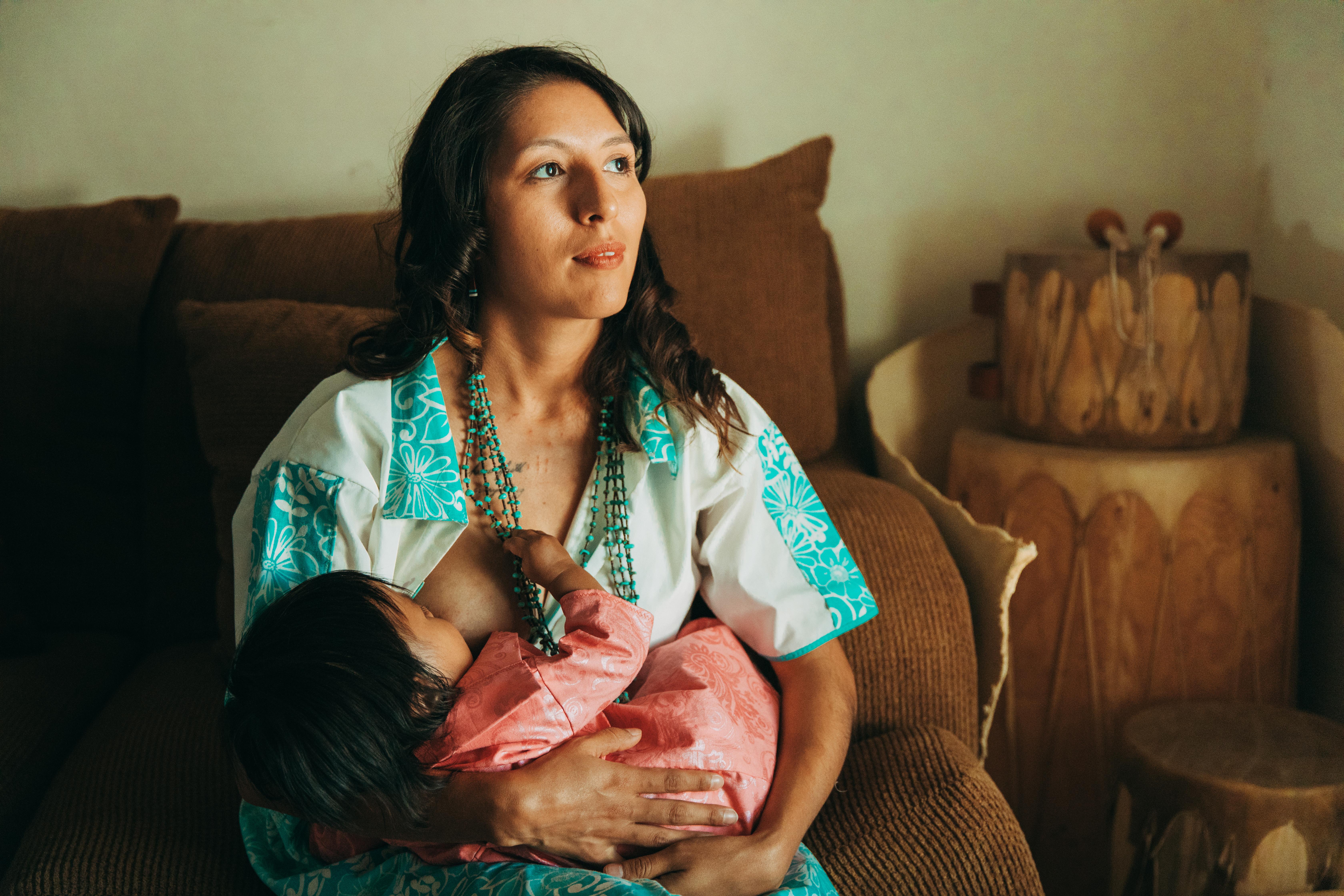 Shaine Garcia breastfeeding her baby