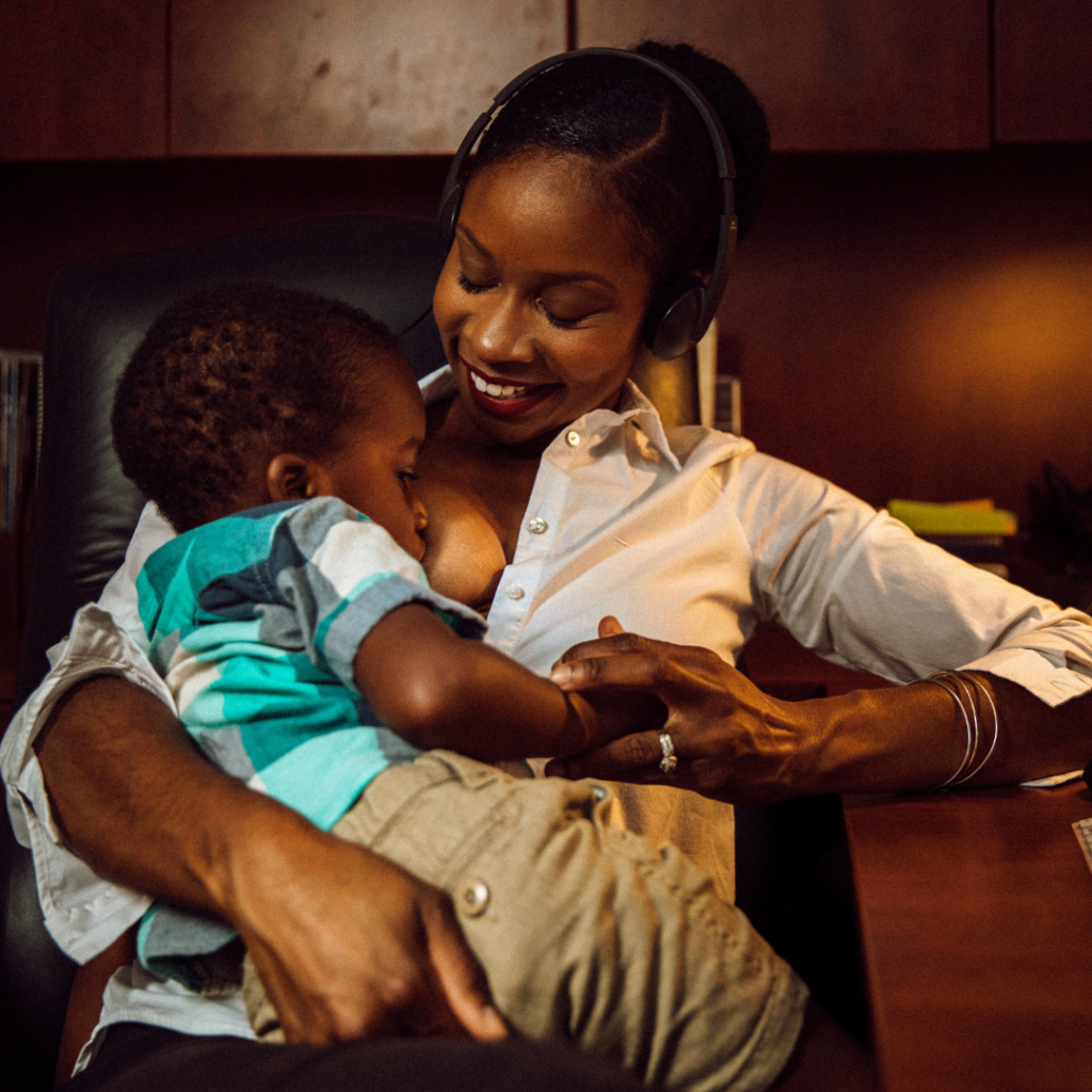 Malikah Garner breastfeeds her son at a work desk