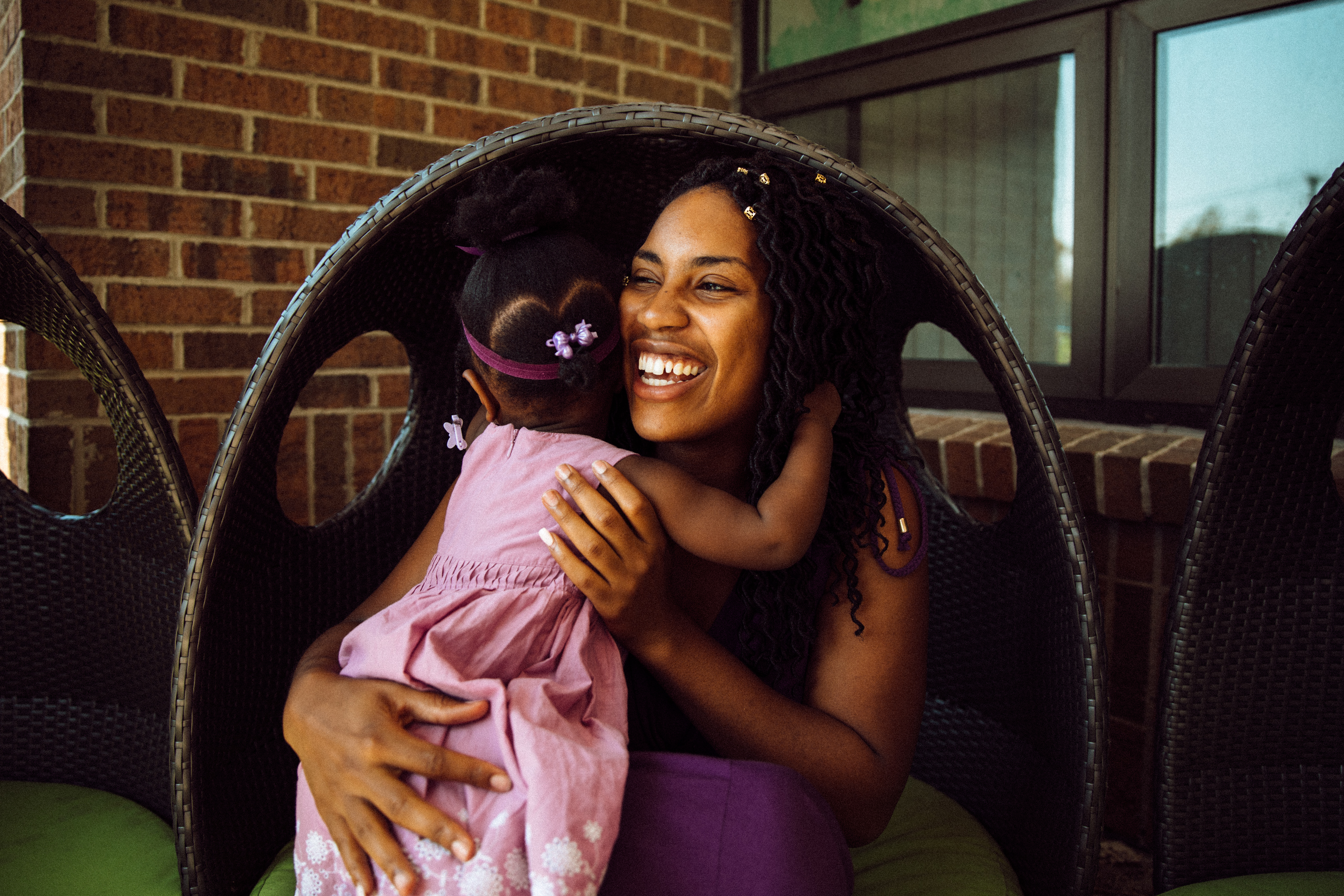 Victoria Washington smiles while giving her daughter a hug