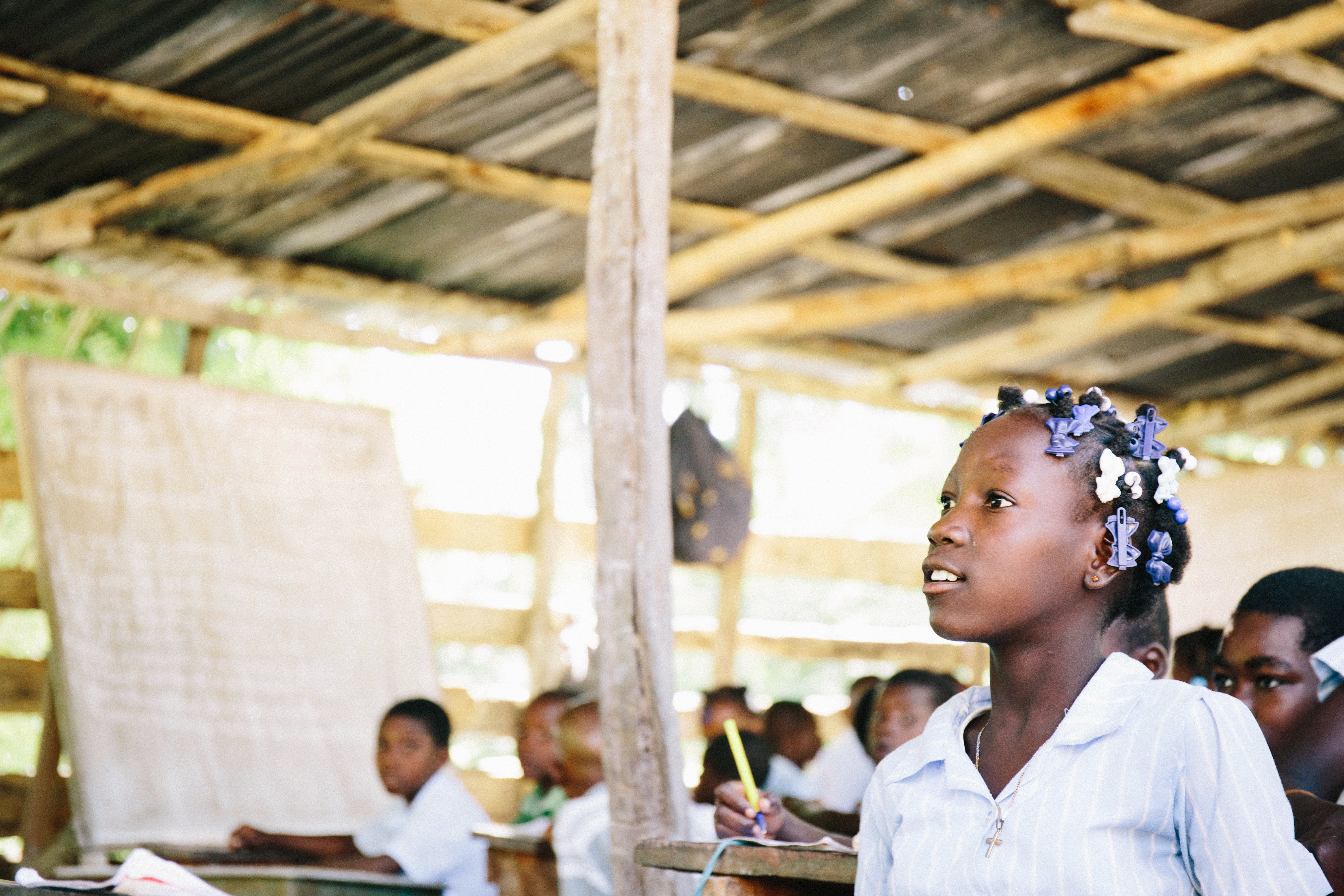 A student sitting in a classroom in Haiti.
