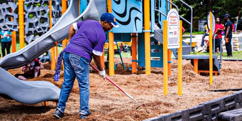 A volunteer helping put the sand in the new KaBOOM! playground in Drew, Mississippi.