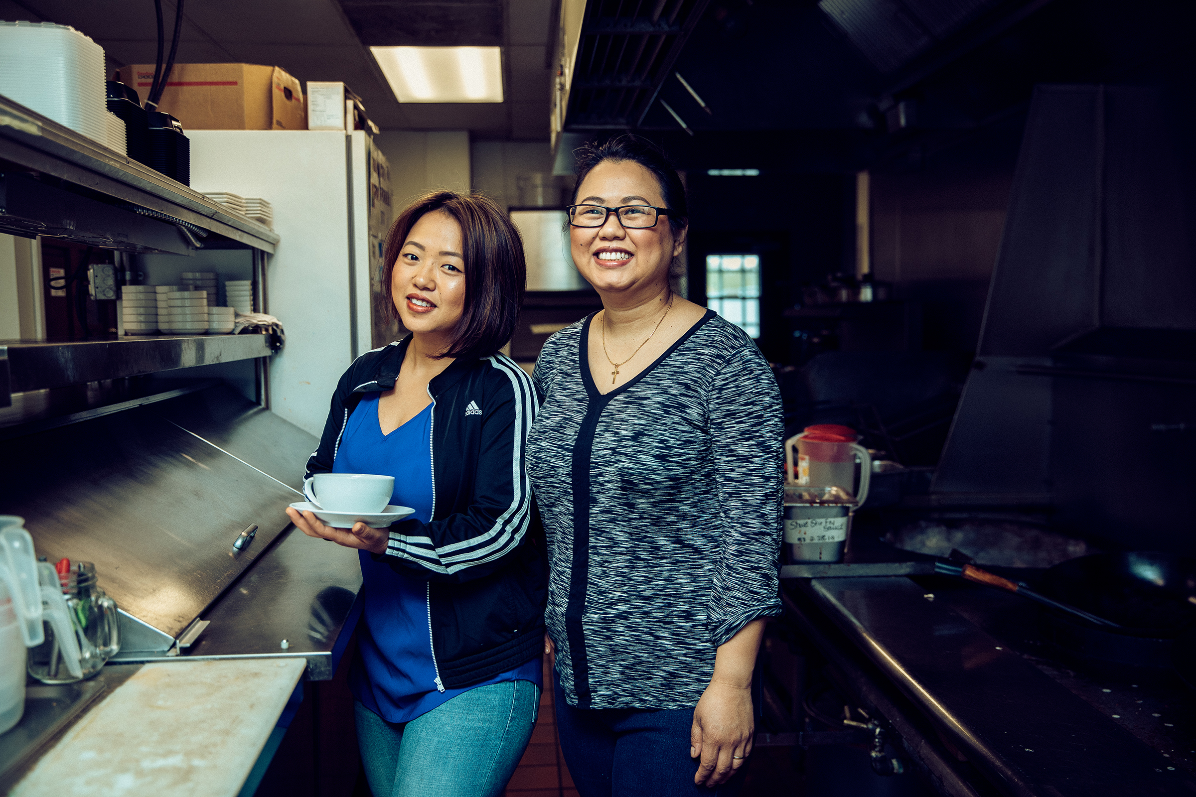 Amanda Sunthang and her mom, owners of Shwe Mandalay Burmese Cuisine restaurant located in Battle Creek, Michigan, standing in the kitchen.