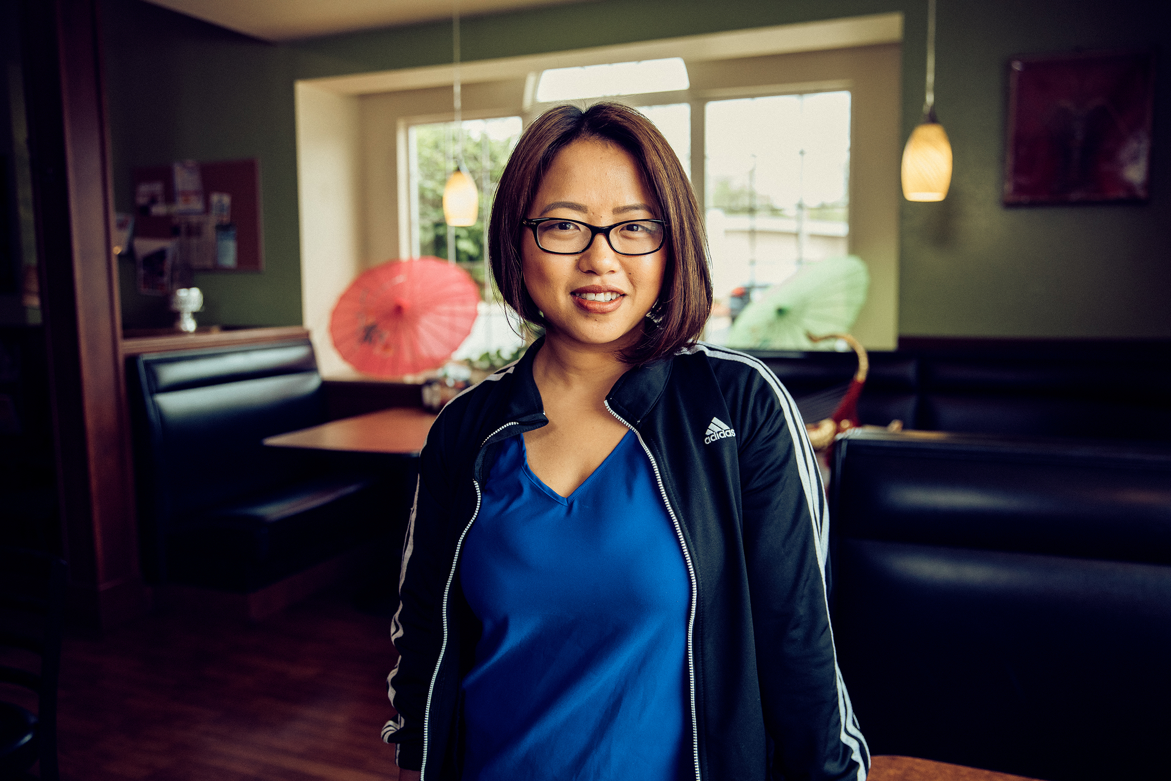 Amanda Sunthang, co-owner of Shwe Mandalay Burmese Cuisine restaurant, looking at the camera with a smile in Battle Creek, Michigan.