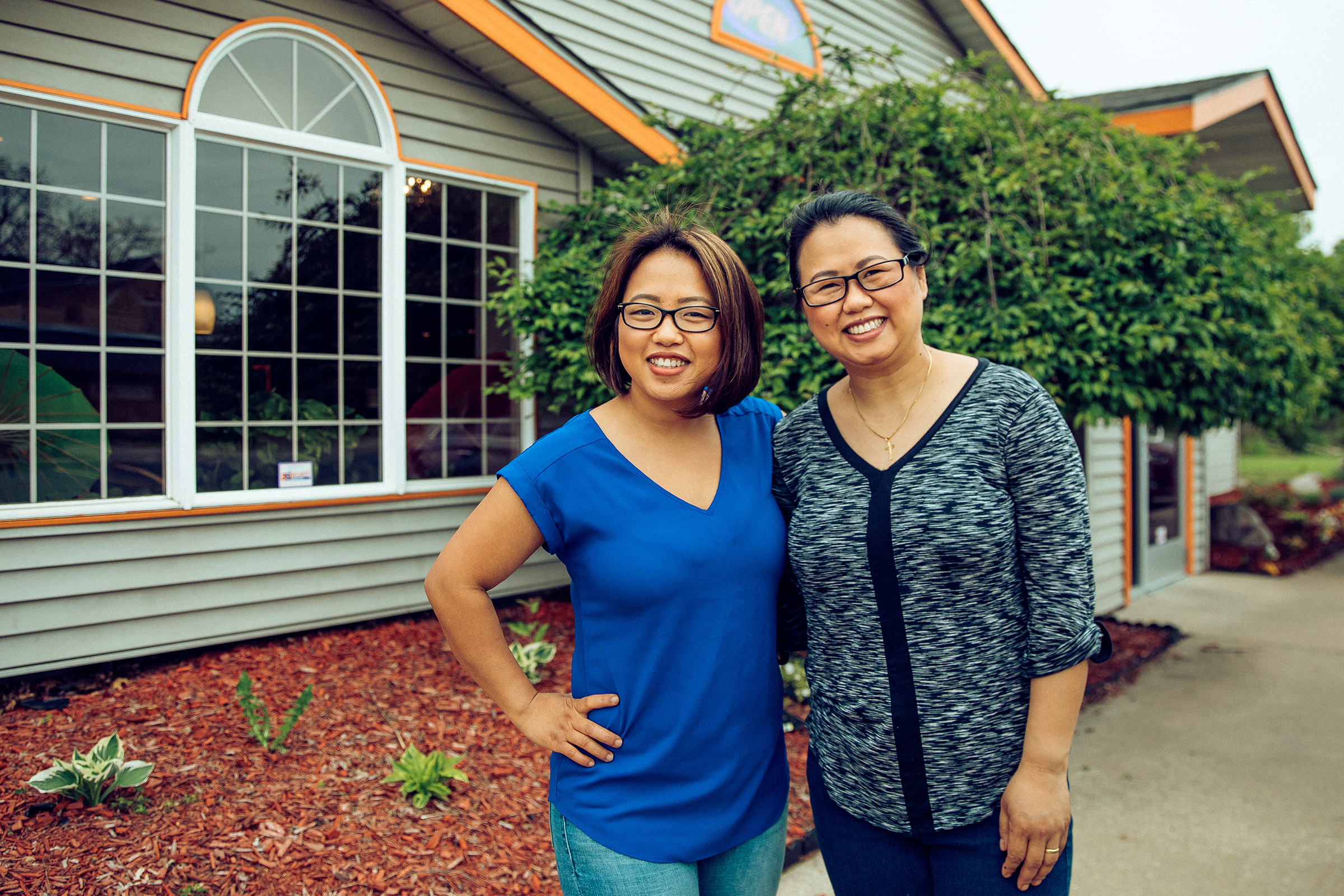 Amanda Sunthang and her sister, Jennifer, owners of Shwe Mandalay Burmese Cuisine, poses outside in front of the restaurant in Battle Creek, Michigan.