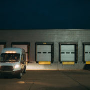 Aequitas van with its headlights on parked in a loading dock area in Battle Creek, MI.