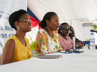 Didi Bertrand and Gisèle Umuhumuza speaking on a panel at the 2019 Forum of Haitian Women Elected Officials.