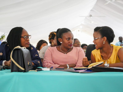 Gisèle Umuhumuza talking with other women at the 2019 Forum of Haitian Women Elected Officials.