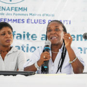 Josette Macillon and Marie-Ange Noel speaking on a panel at the 2019 Forum of Haitian Women Elected Officials.