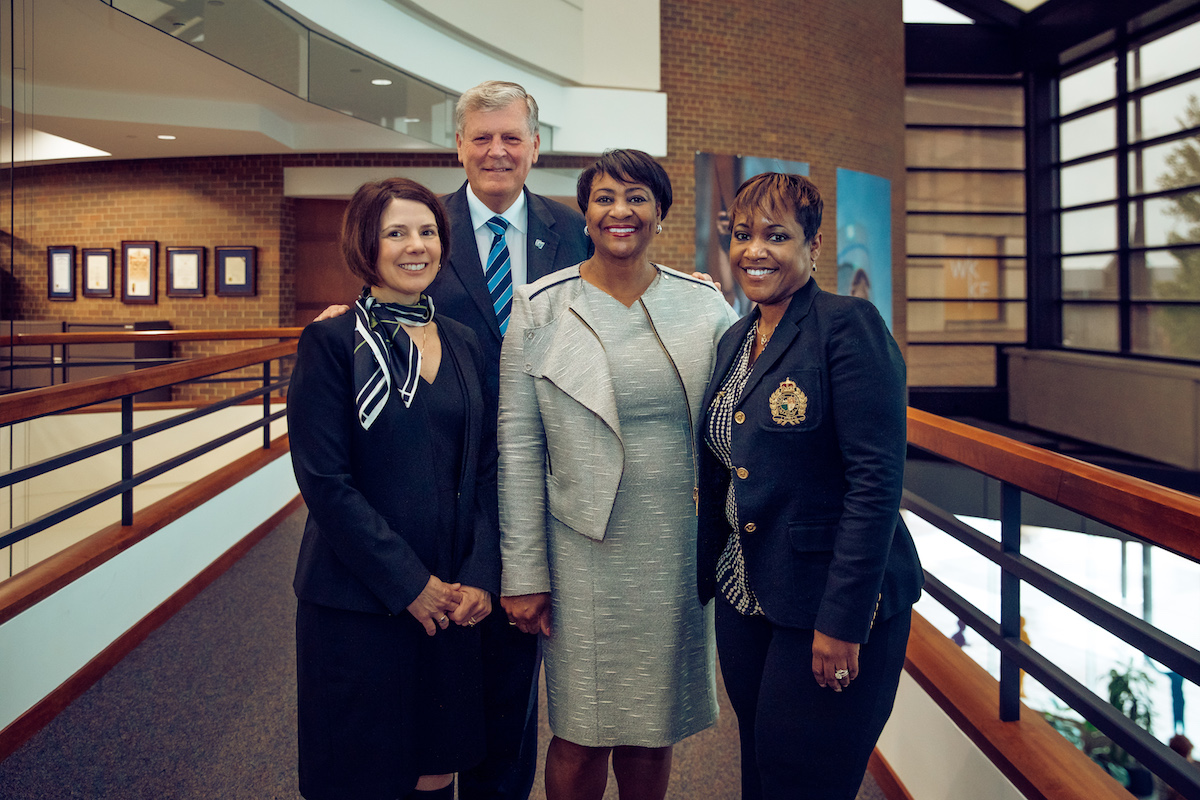 WKKF President and CEO La June Montgomery Tabron with three other people at the WKKF headquarters in Battle Creek, MI.