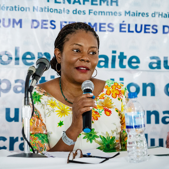 Didi Bertrand speaking on a panel at the 2019 Forum of Haitian Women Elected Officials.