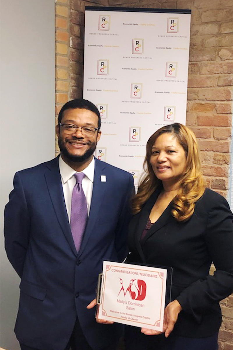 Eric Foster and Clara Guevara, owner of Maily's Dominican Salon and Spa in Grand Rapids, Michigan.