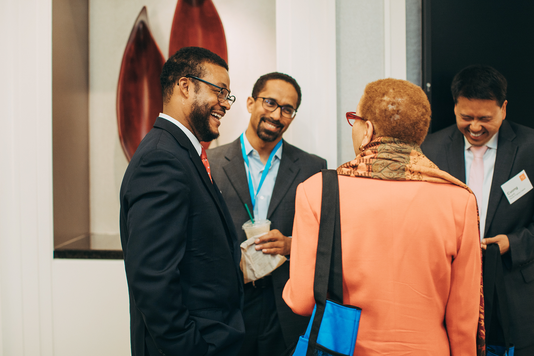 Eric Foster talking with other attendees at the 2019 MDI Portfolio Summit hosted by W.K. Kellogg Foundation in Detroit, Michigan.