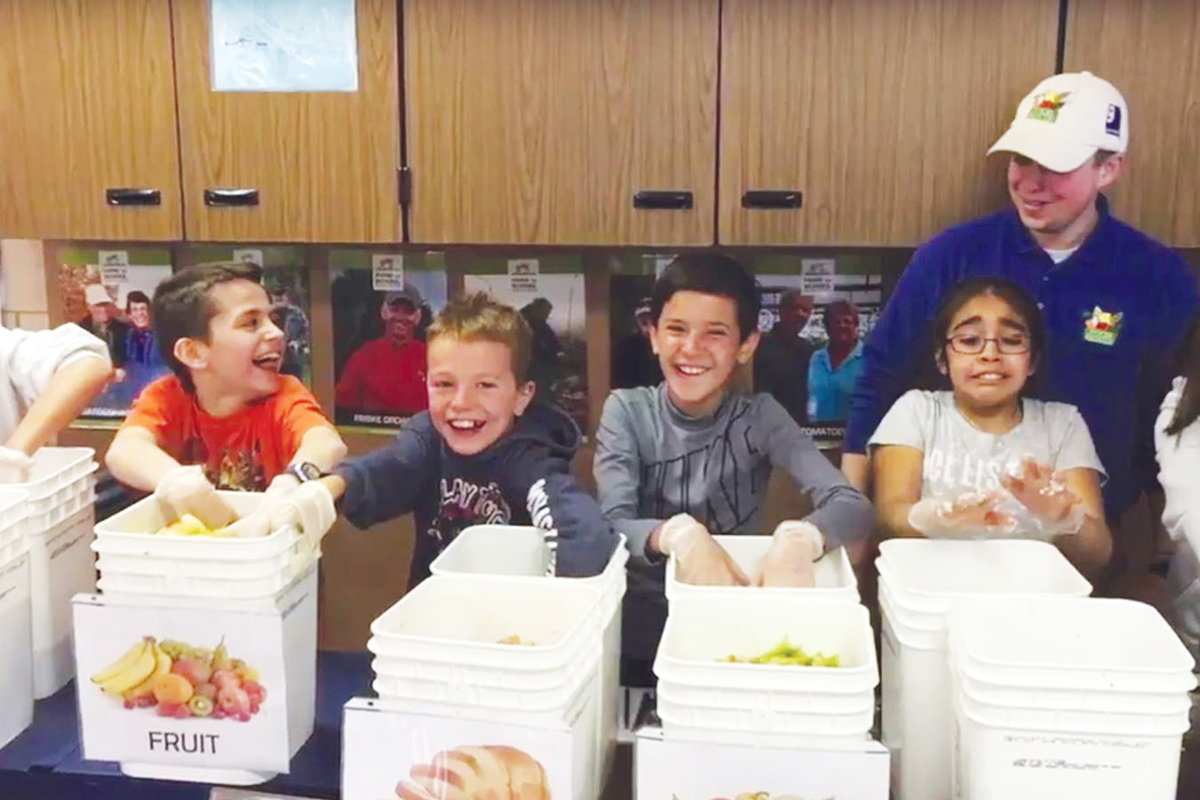 Goodwill Food Rescue Manager Taylor Moore visits Eastern Elementary school in Traverse City, Michigan to educate students on food waste and the benefits of eating local good food year round. Photo: Farm to Freezer.