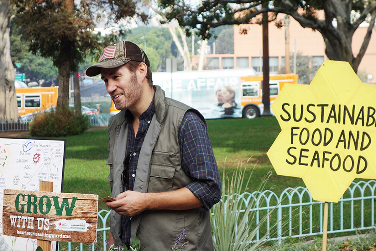 A man talks with people about sustainable growing practices during Los Angeles' Food Day in 2014. Photo: Vince Robbins.