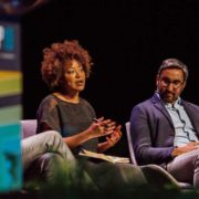 Kesha Cash, founder and general partner of Impact America Fund, speaking on a stage at SOCAP in 2019.
