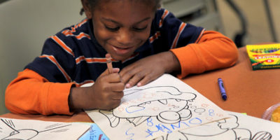 Child enjoying a coloring book