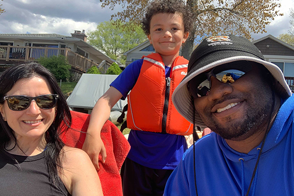 Scott Robinson II, WKKF digital communications officer, with his wife and one of his sons.